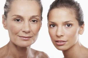 Closeup portrait of two women of different ages on white backgro