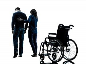 one  man with woman  walking away from  wheelchair  in silhouett